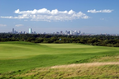 Boston skyline behind Granite Links Golf Club