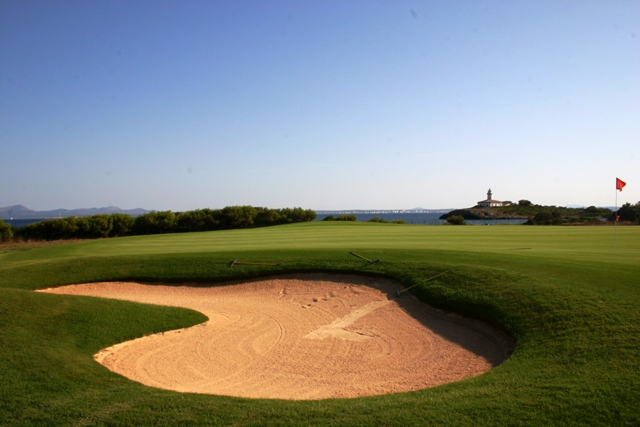 View of the iconic lighthouse at Club de Golf Alcanada in Northern Mallorca