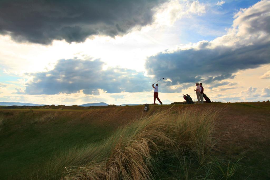 Golfers tee off at Castle Stuart Golf Links, Inverness