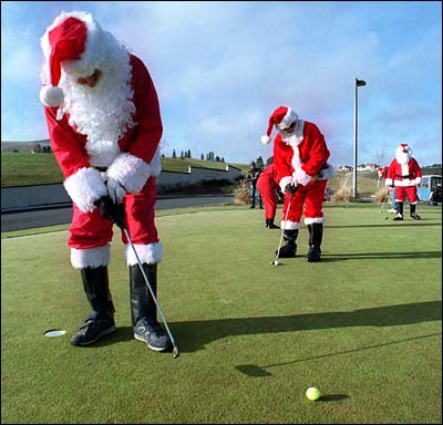 Santa Claus plays golf