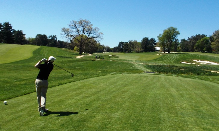 Golfer tees off at Merion Golf Club