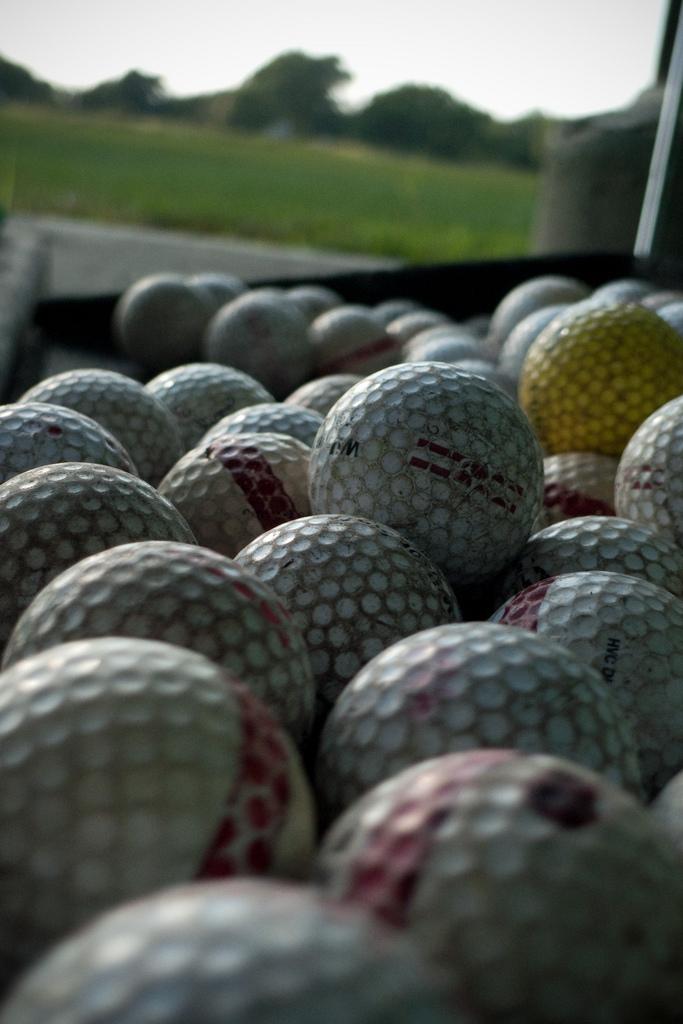 golf balls at a driving range