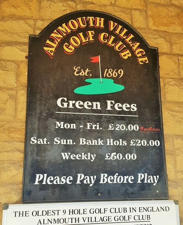 Alnmouth Village Golf Club sign advertising green fees for golfers